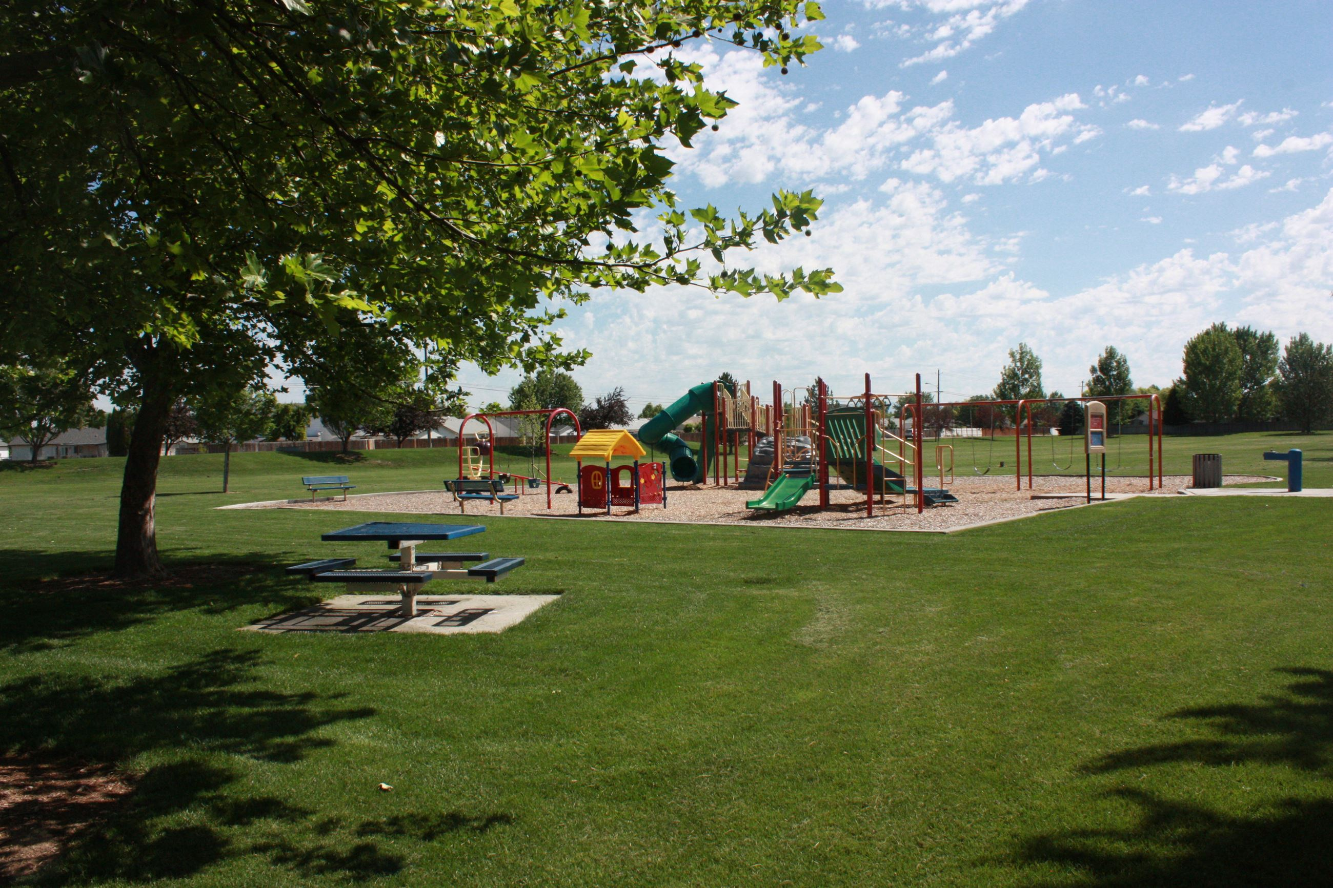 Large play structure with picnic table in front