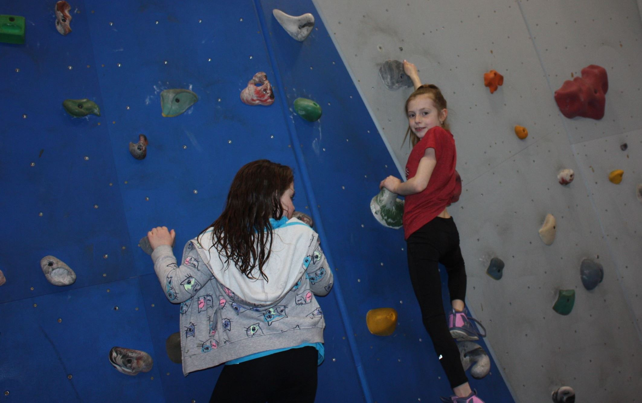 girls climbing on bouldering wall